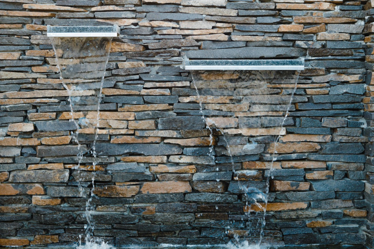 8 Stone Fountain and Waterfall Ideas